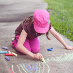 Silver Creek Adventist School student drawing with chalk outdoors